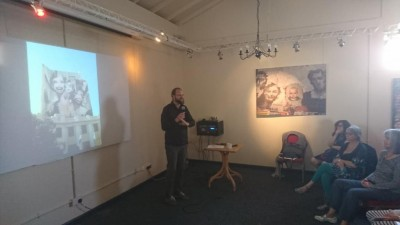 Dr Mikey Georgeson (standing). Unpacking Blake, at Blakefest 2019, held at Felpham Memorial Hall, included an art exhibition featuring installations by Dr Mikey Georgeson, live music from Across The Sea and a panel of speakers presenting different aspects of William Blake's visionary genius.