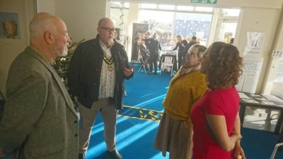 A picture of the Mayor of Bognor having a very deep conversation with Rachel, Lucy and Barry from Blakefest at our pop-up gallery - Dec 2019