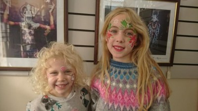 Two very happy looking sisters after having their faces painted by Elissa Barrett from Imagine Face and Body Art.